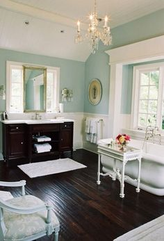 You know, it's the fresh turquoise (or aqua) walls coupled with the crisp white trim and the dark wood floors that make this bathroom so lovely.  I think aqua must be a very calming color to live with, that's why.