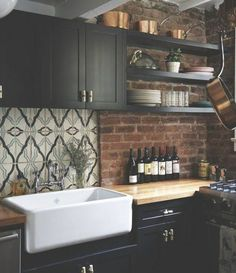 Love the combo of brick and bold pattern backsplash
