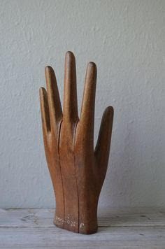 This incredible antique glove mold is so elegant, and so well made! Its solid wood, made in three pieces which slide together and apart with a mortise and tenon joint. The glove maker's name and mold size is beautifully carved into the base; J. Norton 17. It's truly a work of art!