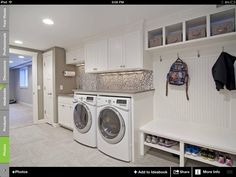 Mud room and laundry combo with a lovely backsplash and cool shelves - Decoist Garage Laundry Rooms, Laundry Room Shelves, Laundry Room Remodel, Laundry Room Organization, Laundry Organizer, Basement Laundry, Mud Rooms, Garage Bedroom, Bathroom Laundry