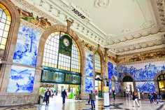 Among the many beautiful things to see in the Portuguese city of Porto, the São Bento train station is a standout. Portugal Train, Visit Portugal, Spain And Portugal, Prague Photos, Monumental Architecture, Travel Memories, Lisbon, Places To See, Travel Inspiration