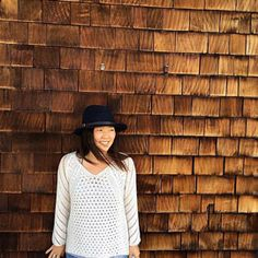 Stitch Fix on Facebook: Woman in front of wood-shingled building