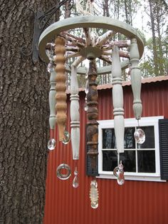 This idea was adapted from one that I saw on the HGTV board, posted by Sharon.S. I took a small old wagon wheel. hung various spindles from it and then attached anything shiney that I could find. This is a fun project for indoors or out.