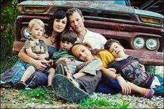 lovely family shot with a vintage car