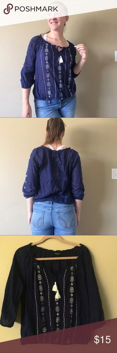 Nine West Navy and White embroidered peasant top Cute Navy and White peasant top! In excellent used condition. This top is super light and airy making it perfect for warmer weather. From a smoke free, pet free home Nine West Tops Blouses