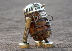 Steampunk R2-D2 Robot Made From Recycled Materials. Created by UK-based artist AmoebaBoy, the R2-D2 look-alike is the spitting image of the beloved Star Wars character but with a steampunk twist.