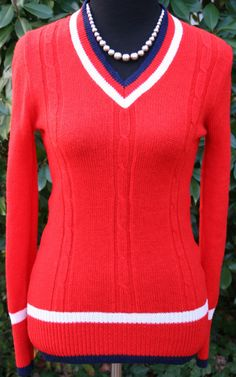 Vintage Red V Neck Sweater with Blue and White Trim Size    Women  Small  LENGTH  26    inches  Chest   ( armpit to armpit) 15 inches across  Waist