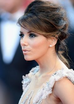Up do  (Eva Longoria at the Cannes Film Festival)  Other views:   http://www.fellisa.com/wp-content/uploads/2012/05/Eva-Longoria-Updo-Hairstyle-at-Opening-Ceremony-of-Cannes-Film-Festival.jpg  http://www.fellisa.com/wp-content/uploads/2012/05/Eva-Longoria-updo-hair-At-Opening-Ceremony-of-Cannes-Film-Festival.jpg