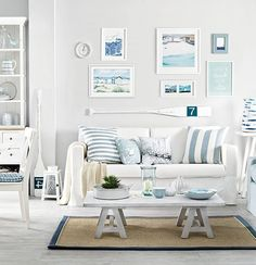 Coastal beach gallery wall over the sofa in white and blue: http://beachblissliving.com/wall-decor-ideas-for-above-sofa/