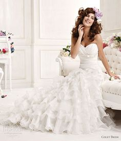 This draped bodice has a gorgeous simple look with a ruffle bottom which makes a beautiful wedding dress. I