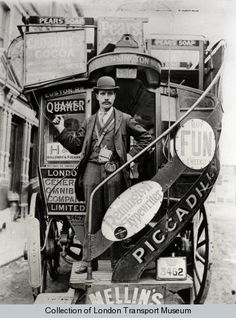 London General Omnibus Corporation horse bus conductor in bowler hat and long jacket standing on the boarding platform of the bus. The conductor sports a Bell punch ticket machine and enamel licence badge no 9116. His right hand is grasping the cord...