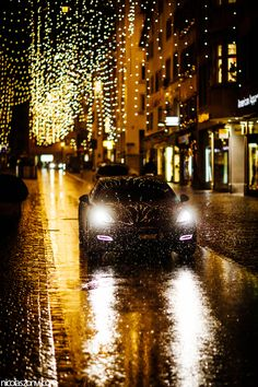 I love the lights!! I love the car and of course I love how it's raining. The whole picture just goes together! Words: Car, pretty, beautiful, different, awesome, rain, lights, cold, blurred