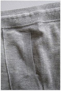 BASEMENT | MEASYOU YOUASME | Unisex fine knit long john pants with low crotch in cotton/wool blend. Ribbed waistband with drawstring, pintuck creases continuing all the way down into high ribbed cuffs, 2 front pockets and no sideseams. Composition: 63% Cotton, 30% Wool, 7% Polyamide, 12 gauge.