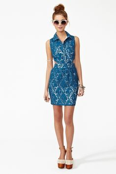Amazing blue lace dress featuring a button-down front and side cutouts. Front pockets, hook/eye and zip closure at side. Cream lining. Looks cute paired with a crossbody bag and wedges!