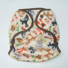 This outdoorsy sweet diaper cover is a size small. It will fit an approximately 8-20 pounds or 3-6 months size baby.  Adjustable with poly resin snaps  Made from waterproof PUL Machine wash, Tumble dry, No iron  Can be used with a prefold or fitted diaper. Fold a prefold into thirds and lay inside the cover, fold all at once over baby and snap in place. No pins or other closer required. This listing is for the Size Small Woodsy Animal cover. Our dear little friend is showing off her own…