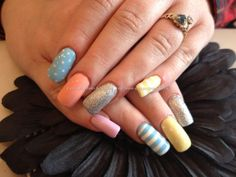 Acrylic nails with pastel coloured polishes and nail art