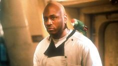 "LL Cool J as Sherman ""Preacher"" Dudley: Comic Relief cook, Bible-quoting man with a profanity-spewing parrot mascot. Unlike others, he has realistic expectations of ""death-by-shark"" but is one of the only two survivors at the end!"