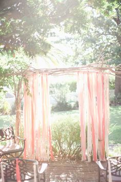 DIY ceremony backdrop with long ribbons. Also could serve as an archway along the aisle.