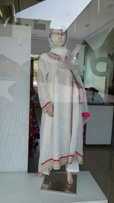Pure white chiffon dress by Rubaksha.  For more information contact  9945743423