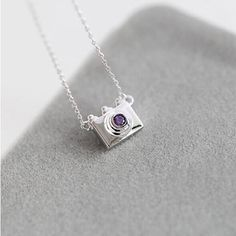 Photographer in Soul is a gorgeously done vintage camera, women's necklace pendant in real 925 Sterling Silver and Purple Crystal Rhinestone CZ. Great for anyone who loves photography and fun style.