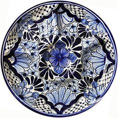 Serve your guests your best hors d'oeuvres from this charming Talavera snack platter!  With an ample center bowl for dip or guacamole, plus four outer sections for chips and crackers, all your party details will be fully covered.  Handmade in Dolores Hidalgo, Mexico.