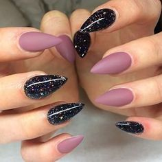 Black Galaxy polish with matte mauve stiletto nails