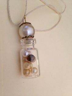 A personal favorite from my Etsy shop https://www.etsy.com/listing/244342888/bottle-necklace-pearl-bottle-necklace