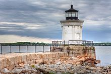 The Portland Breakwater Light (also called Bug Light) is a small lighthouse in South Portland, Maine. The lighthouse's flashing red beacon helped guide ships from Casco Bay through the entrance to Portland Harbor.