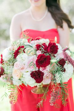 pink and red floral arrangement - photo by Vanessa Velez Photography http://ruffledblog.com/whimsical-retro-inspired-wedding