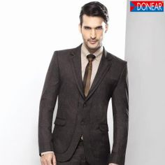 Team brown tie with grey suit to mark a lasting impression.