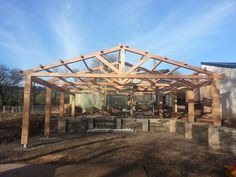 British grown Larch fabricated glulam structure  by Buckland Timber.