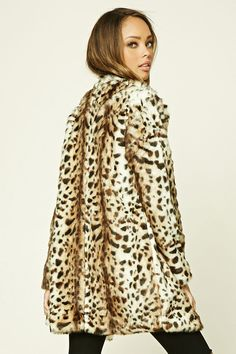 A faux fur coat by TWELVE™ featuring an allover leopard print, long sleeves, and snap-button closure