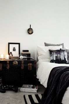 Bedroom details. Vintage trunk with an intermingling of intricate antiques + clean modern pieces.