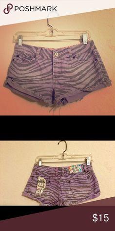 Billabong Lavender Tiger Shorts Lavender tiger print billabong jean shorts! Size 1 and very cute, like new! (Style is beach weathered). Billabong Shorts Jean Shorts