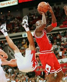 The Hawks' Eldridge Recasner ends up awkwardly airborne in trying to guard the GOAT during a playoff game in Atlanta.