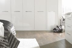 A closer look at the high shine of this range's Pure White gloss finish. http://www.sharps.co.uk/fitted-bedrooms/pure/