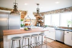 Voila! New wood floors make a huge difference, but the brick backsplash, stainless appliances and gorgeous black granite countertops don't hurt either.