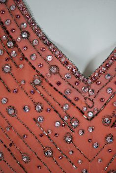 And a detail of the embroidery on the 1975 Christian Dior dress.