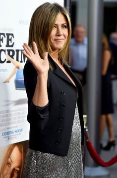Trending Fashion Style: Men's Jacket over the Dress. Jennifer Aniston in Saint Laurent cropped black blazer over shimmering silver metallic sequin dress + clutch bag + strappy high-heels at the premiere of 'Life Of Crime' L.A. August 2014.