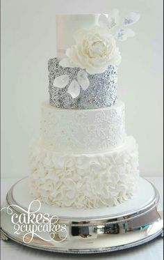 Silver and white wedding cake with flower accent & Sequin Wedding Cakes with metallic gold and silver accents via The Magazine White Wedding Cakes, Cool Wedding Cakes, Beautiful Wedding Cakes, Gorgeous Cakes, Wedding Cake Designs, Elegant Wedding, Trendy Wedding, Silver Winter Wedding, White Silver Wedding