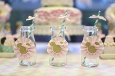 Cute milk bottle drinks at a Minnie Mouse Party.  See more party ideas at CatchMyParty.com.  #minniemousepartyideas
