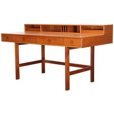 Danish Teak Wood Flip Top Desk by Peter Lovig-Nielsen, 1970s | From a unique collection of antique and modern desks at https://www.1stdibs.com/furniture/storage-case-pieces/desks/