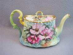 T & V TRESSEMANES & VOGT Limoges France Tea pot  http://www.ebay.com/itm/Tea-Set-Sugar-Bowl-Creame-T-V-TRESSEMANES-VOGT-Limoges-France-Venice-Roses/350897355782?_trksid=p2047675.m2109&_trkparms=aid%3D555003%26algo%3DPW.CAT%26ao%3D1%26asc%3D18522%26meid%3D2192972559525009418%26pid%3D100010%26prg%3D8431%26rk%3D4%26rkt%3D15%26sd%3D190884281167%26