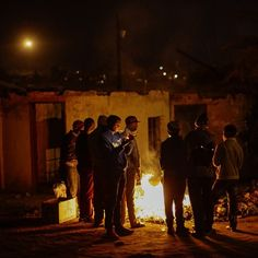 """Pic by @kevsutherland """"Youths gather around a fire for warmth during mid winter in Meqeleng, a township outside of Ficksburg in the Eastern Free State bordering Lesotho."""" #TheLightContinent #sundaytimesza #photojournalism #documentary #africa #southafrica"""