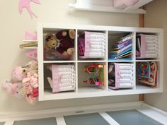 Ava's room. Great storage idea for books, toys, puzzles etc.  www.absoluteamy.com