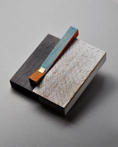 Julia Turner, Mill Brooch #5, Mixed wood, stain, sterling 18k gold, 2 1/2 x 2 /14 x 1/2″
