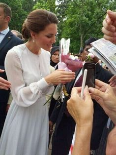 Love how genuinely interested she is when visiting crowds (the people)!