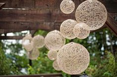 We could make these with balloons, yarn, and paper machè mix!