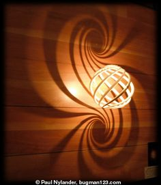 Loxodrome Sconce Printing Wonders printed Loxodrome Lamp, which illuminates a double spiral of light onto the wall using stereographic projection. Diy Luminaire, Luminaire Design, Cool Lighting, Lighting Design, Tuscan House, Math Art, 3d Prints, Cool Ideas, Deco Design