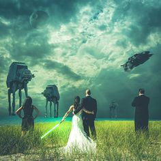 """At their wedding in Michigan on Friday, """"Star Wars"""" fans John and Mindy Doychich (along with their maid of honor and best man) prepared for battle against AT-ATs and the Death Star in a shot captured and edited by photographer Steven Kowalski."""